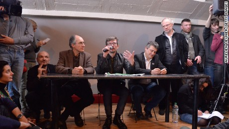 PARIS, FRANCE - JANUARY 13:Charlie Hebdo lawyer, Richard Malka (L), Charlie Hebdo editor in chief,  Gerard Briard (2L) Charlie Hebdo cartoonist, Renald Luzier (C) aka Luz, Patrick Pelloux (3R), Charlie Hebdo journalist and the President of Liberation, Laurent Joffrin (2R) during the Charlie Hebdo press conference held at the Liberation offices in Paris on January 13, 2015 in Paris, France.  The press conference was held to accounce the next issue following the terrorist attack last Wednesday against Charlie Hebdo where 12 people were killed.  (Photo by Aurelien Meunier/Getty Images)