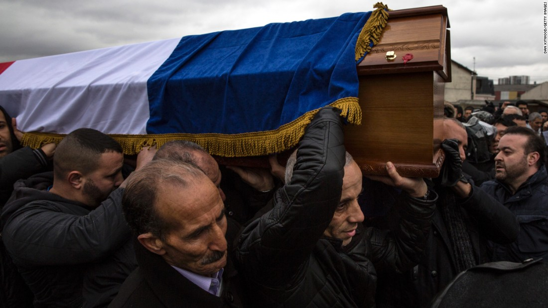 The funeral for police officer Ahmed Merabet takes place in Bobigny, France, on January 13. He helped pursued the attackers who opened fire at the Paris office of Charlie Hebdo magazine.
