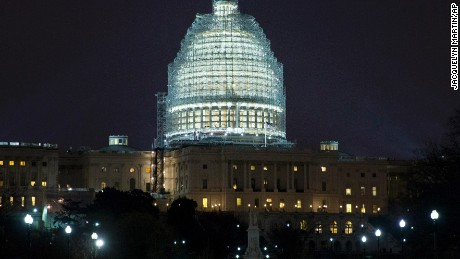 Lights illuminate the The U.S. Capitol, which is covered in scaffolding for ongoing restoration of the Capitol dome, in Washington, Wednesday, Jan. 14, 2015. (AP Photo/Jacquelyn Martin)