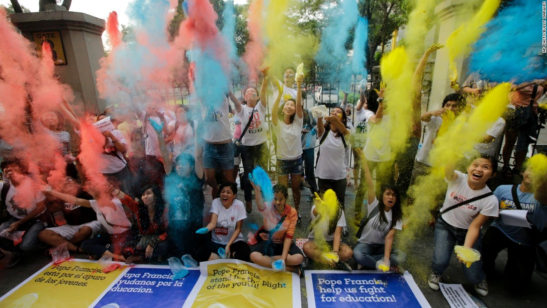 Youth and students throw colored powder in the air at the start of the countdown to welcome Pope Francis, on January 14 in Manila, Philippines.