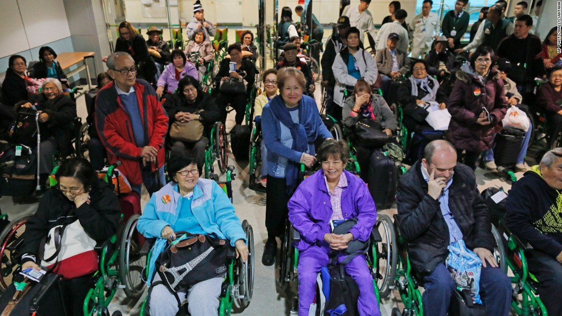 Forty elderly passengers wait to board their connecting flight to the Philippines at the Taoyuan International Airport in Taiwan on January 14. The elderly passengers, mostly Filipino, embarked on the long journey to the Philippines from the US and Canada in hopes of catching a glimpse of Pope Francis during his five day visit, a part of his Asia tour.