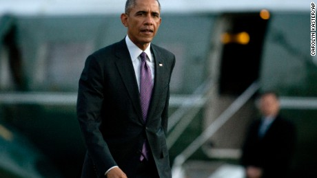 President Barack Obama walks from Marine One across the South Lawn to the Oval Office of the White House, Thursday, Jan. 15, 2015, in Washington, as he returns from Baltimore where he attended the Senate Democratic Issues Conference and visited Charmington's Cafe where he talked about  paid sick leave for working Americans.