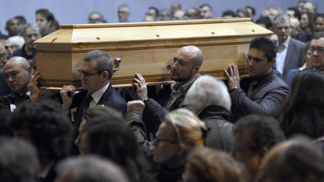 "Charlie Hebdo editor Stephane ""Charb"" Charbonnier is put to rest in Pontoise, France, on January 16."