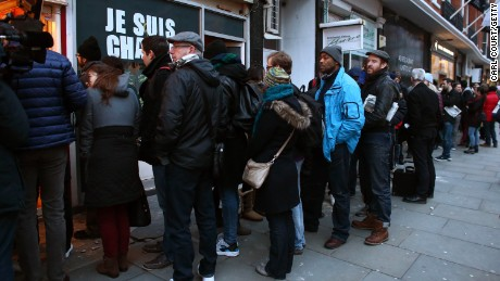People queue for copies of the latest edition of Charlie Hebdo at a French bookstore in London on on January 16.