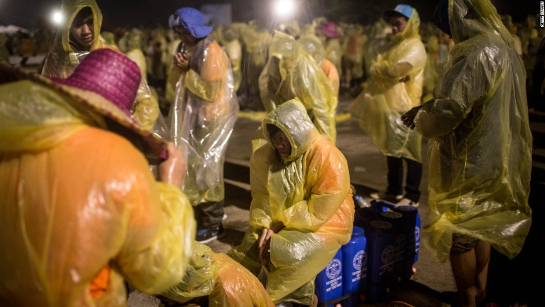 Pilgrims sit through heavy rain and high winds as they wait for the arrival of Pope Francis at Tacloban Airport on January 17.