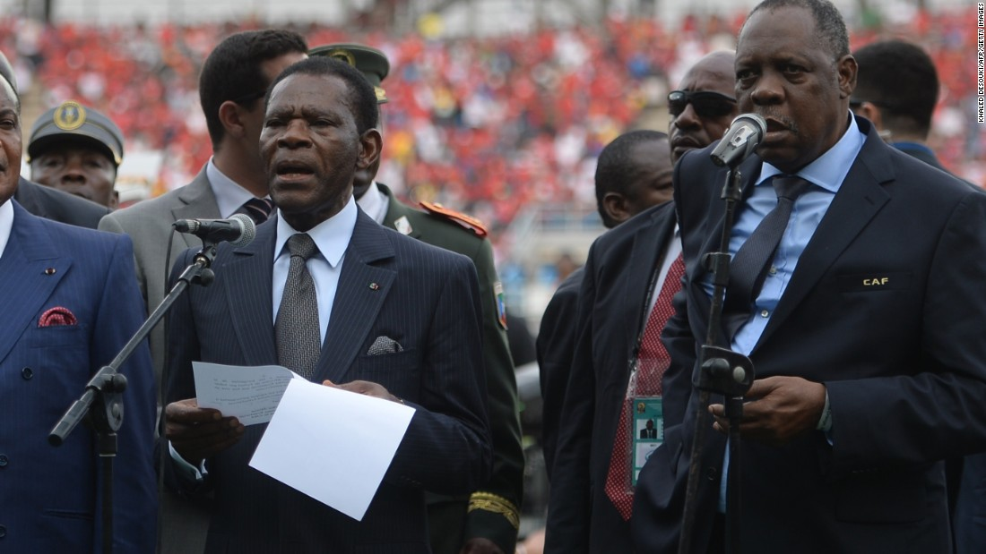Equatorial Guinea's president Teodoro Obiang Nguema Mbasogo (center) opens the 16-nation tournament alongside Confederation of African Football president Issa Hayatou (right).