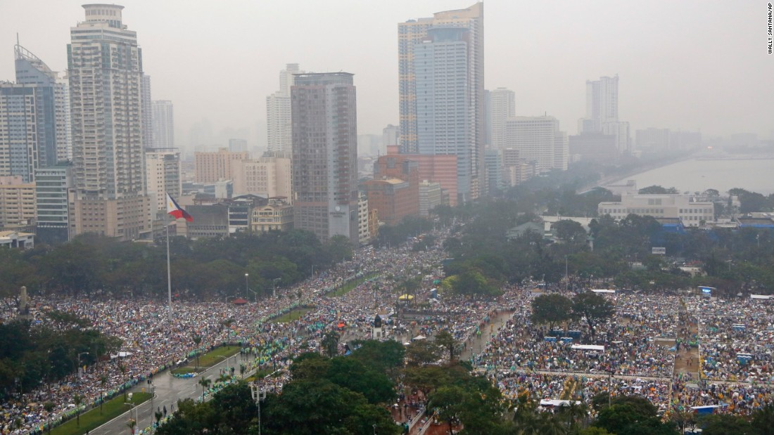 Millions brave the falling rain as they fill Rizal Park and the surrounding area in Manilla on January 18 to hear Pope Francis celebrate mass.