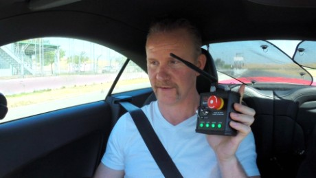 Morgan Spurlock gets ready to ride in a self-driving race car.