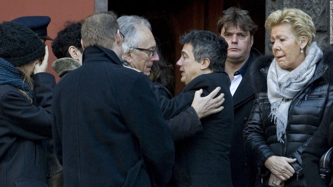 Gerard Gaillard, one of the survivors of the Charlie Hebdo attack, and Patrick Pelloux, doctor and Charlie Hebdo contributor, comfort each other during the funeral of Michel Renaud on Wednesday, January 14. Renaud was the former chief of staff for the mayor of Clermont-Ferrand, France.