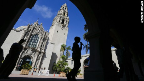 In this Oct. 2, 2013, picture, a boy walks past a building in Balboa Park in San Diego. Balboa Park will be marking its 100th anniversary in 2015 with a host of festivities, although any day is worth a visit to the 1,200-acre urban oasis that rivals New York's Central Park and is home to the San Diego Zoo.  (AP Photo/Gregory Bull)