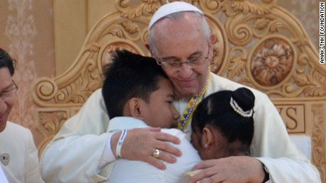Pope Francis hugs two former street children at a ceremony in Manila, Philippines on Sunday, January 18.
