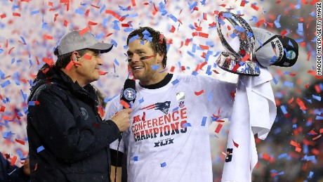 Tom Brady of the New England Patriots holds up the Lamar Hunt Trophy after defeating the Indianapolis Colts in the 2015 AFC Championship Game Sunday in Foxboro, Massachusetts.