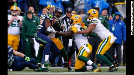 Chris Matthews #13 of the Seattle Seahawks grabs ahold of an onsides kick during the fourth quarter of the NFC Championship game against the Green Bay Packers  at CenturyLink Field on January 18, 2015 in Seattle, Washington.