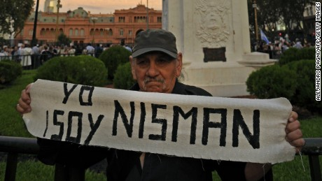 a demo at Mayo square, in Buenos Aires on January 19, 2015, against the death of Argentine public prosecutor Alberto Nisman, who was found shot dead earlier, just days after accusing President Cristina Kirchner of obstructing a probe into a 1994 Jewish center bombing. Nisman, 51, who was just hours away from testifying at a congressional hearing, was found dead overnight in his apartment in the trendy Puerto Madero neighbourhood of the capital. 'I can confirm that a 22-caliber handgun was found beside the body,' prosecutor Viviana Fein said. The nation's top security official said Nisman appears to have committed suicide. AFP PHOTO / ALEJANDRO PAGNI AFP PHOTO / ALEJANDRO PAGNI (Photo credit should read ALEJANDRO PAGNI/AFP/Getty Images)