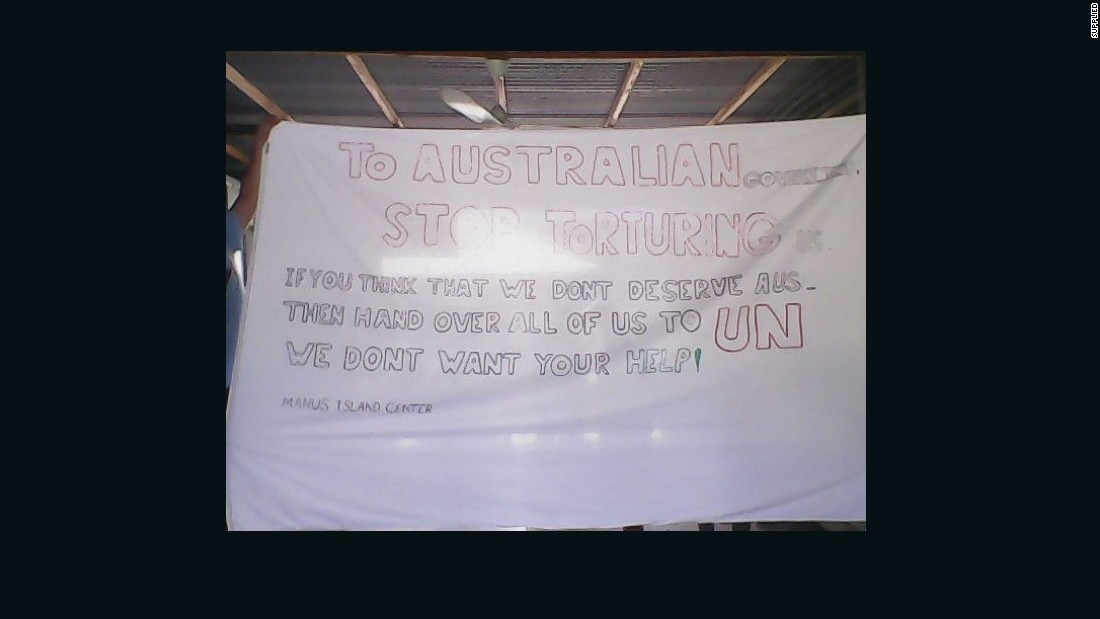 A sign hanging in one of the compounds urges the United Nations to step in. Hundreds of men have been detained at the Australian processing center on Manus Island in Papua New Guinea for 18 months while they wait for their asylum claims to be processed.