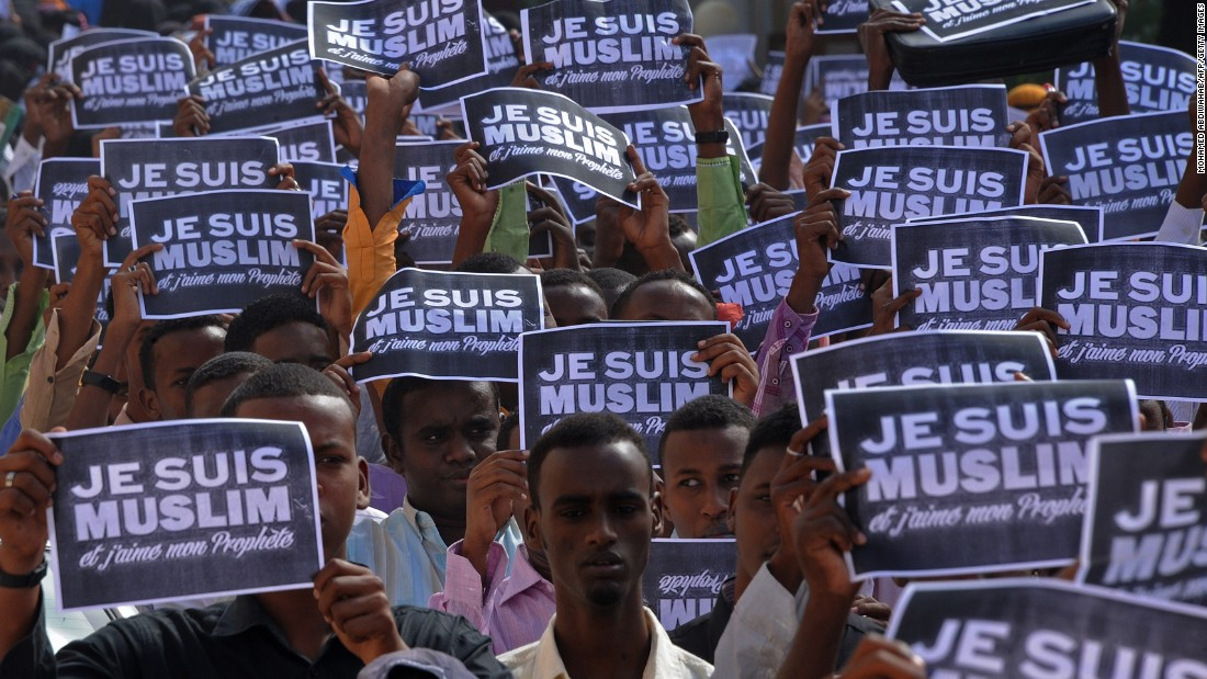"Protesters hold signs which say, in French, ""I am a Muslim and I love my Prophet"" in Mogadishu, Somalia, on Saturday, January 17."