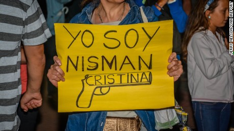 The mood changed from calm to anger as the sun set Monday in Buenos Aires, Argentina. A sea of protesters alleged a government cover-up in the mysterious death of prosecutor Alberto Nisman, who was found dead in his apartment just hours before his testimony about a 1994 Buenos Aires bombing.  http://ireport.cnn.com/docs/DOC-1208078