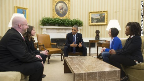 US President Barack Obama speaks with people who wrote him personal letters throughout the year, and who will attend tonight's State of the Union address, in the Oval Office of the White House in Washington, DC, January 20, 2015. Seated alongside Obama are: Victor Fugate (L) of Kansas City, Missouri; Rebekah Erler of Minneapolis, Minnesota (2nd L), Carolyn Reed (2nd R) of Denver, Colorado; and Katrice Mubiru (R), Woodland Hills, California.