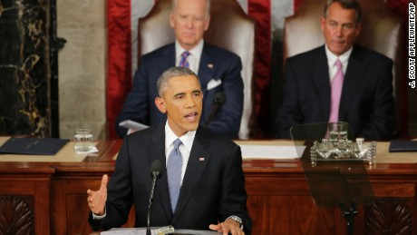 Vice President Joe Biden and House Speaker of Ohio listen as President Barack Obama gives his State of the Union address before a joint session of Congress on Capitol Hill in Washington, Tuesday, Jan. 20, 2015. (AP Photo/J. Scott Applewhite)