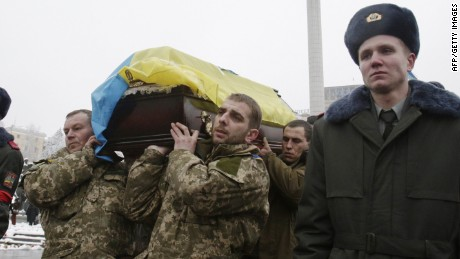 "Ukrainian servicemen carry on January 20, 2015 at Independence Square in Kiev, the coffin of Sergii Nikonenko, 53, fighter of Azov volunteer battalion, who died during ATO (Anti-Terrrorist Operation) in the east of the country. Russia's defence ministry denied on January 20 as ""absolute nonsense"" the latest accusations by Kiev that Moscow had sent hundreds of troops over the border into Ukraine. AFP PHOTO/ ANATOLII STEPANOVANATOLII STEPANOV/AFP/Getty Images"