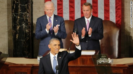 President Barack Obama waves before giving his State of the Union address before a joint session of Congress on Capitol Hill in Washington, Tuesday, Jan. 20, 2015. House Speaker John Boehner of Ohio and Vice President Joe Biden applaud