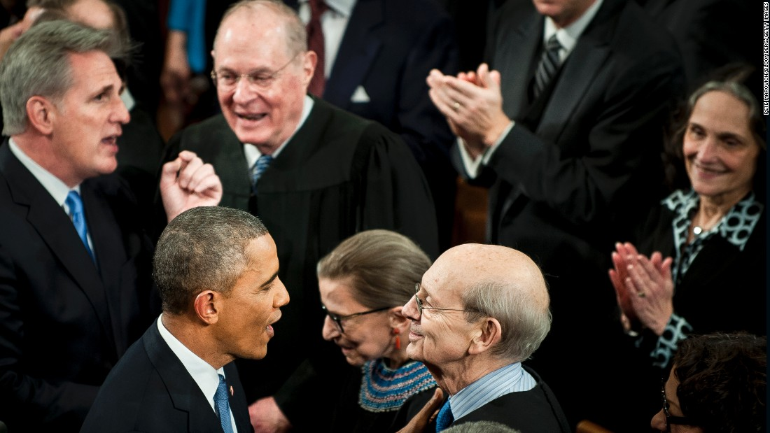 Obama, speaks with Supreme Court Justice Stephen Breyer as he enters the House.