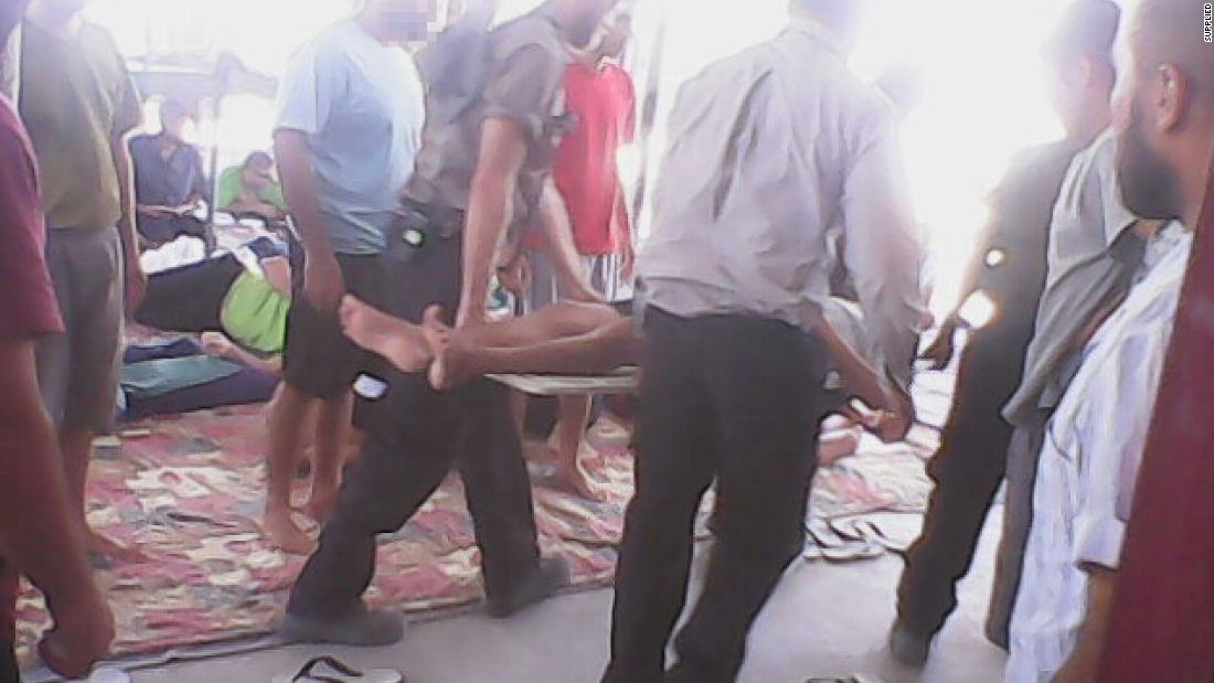 A hunger striker is carried away on a stretcher from one of the compounds at Manus Island detention center in a photo taken on January 19.