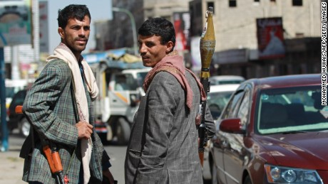 Members of the Shiite Huthi movement man a checkpoint near the presidential palace in the capital, Sanaa, on January 21, 2015 after they seized control of Yemen's presidential palace and attacked President Abdrabuh Mansur Hadi's  residence the previous day in what officials said was a bid to overthrow the government, drawing condemnation from the UN Security Council. The Huthis have abducted Hadi's chief of staff, Ahmed Awad bin Mubarak, a southerner, and have encircled the residence of Prime Minister Khalid Bahah since January 19, in a push to extract changes to a draft constitution opposed by the militia. AFP PHOTO / MOHAMMED HUWAIS        (Photo credit should read MOHAMMED HUWAIS/AFP/Getty Images)