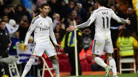 Real Madrid's Portuguese forward Cristiano Ronaldo (L) celebrates with Real Madrid's Welsh forward Gareth Bale after scoring a goal during the Spanish league football match Real Madrid CF vs RC Celta de Vigo at the Santiago Bernabeu stadium in Madrid on December 6, 2014. AFP PHOTO/ JAVIER SORIANO (Photo credit should read JAVIER SORIANO/AFP/Getty Images)