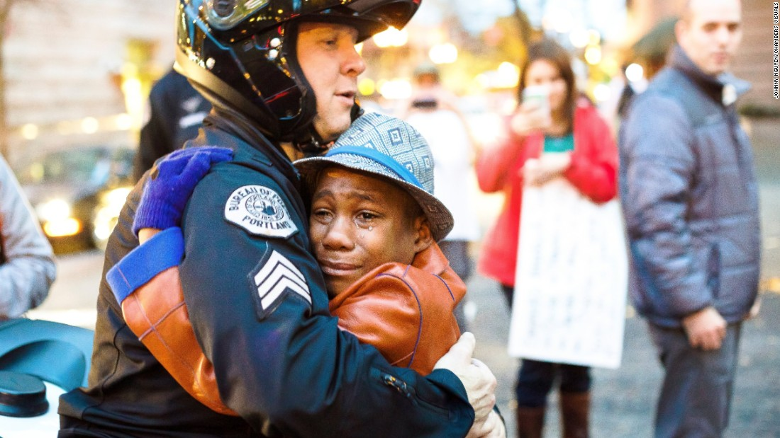 "Here <a href=""http://www.cnn.com/2014/11/29/living/ferguson-protest-hug/"">12-year-old Devonte Hart </a>and Portland, Oregon, police Sgt. Bret Barnum share a hug at a November 2014 rally to protest officer-involved killings like the one in Ferguson, Missouri."