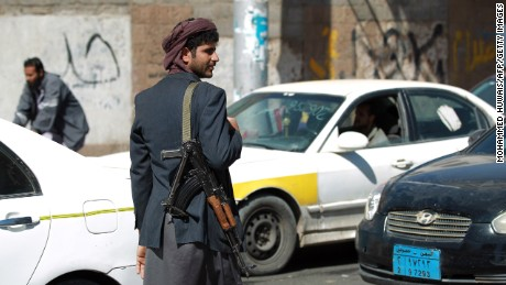 A Houthi mans a checkpoint near the presidential palace in Sanaa on January 21.