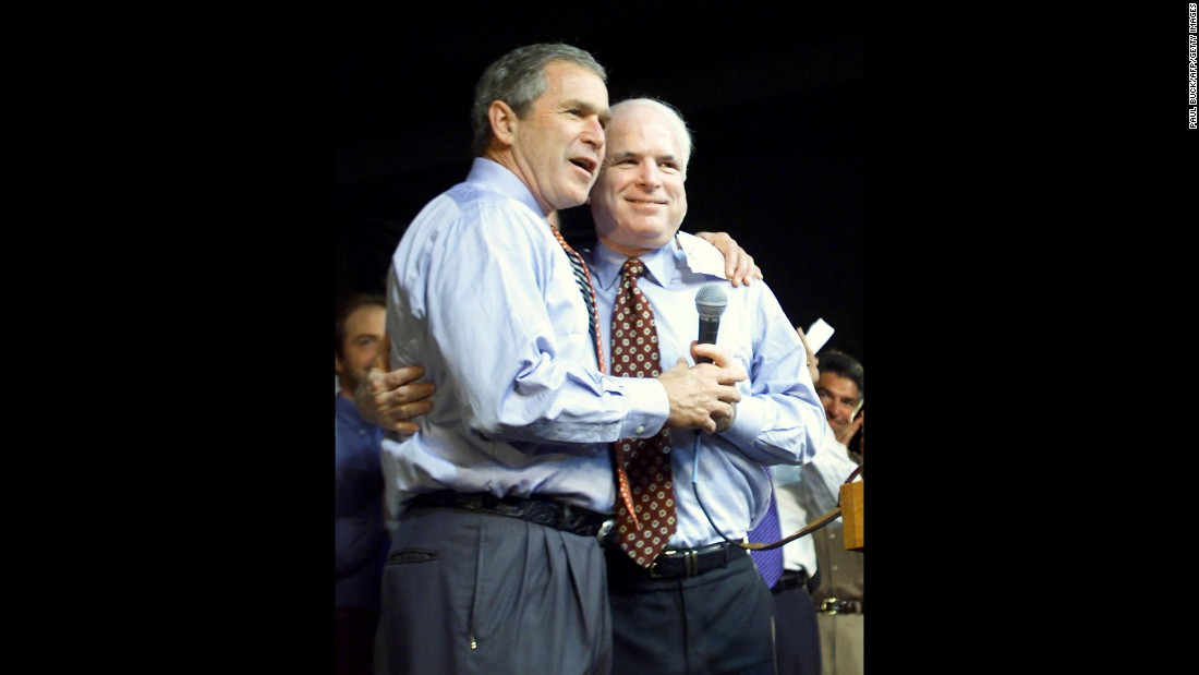 Then-presidential candidate and Texas. Gov. George W. Bush (left) and Sen. John McCain of Arizona give each other a little bro love on stage at a rally in Daytona Beach, Florida, in 2000.