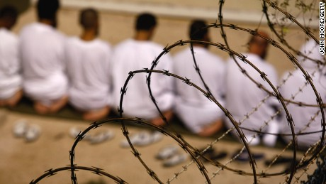 File photo: A group of detainees kneels during an early morning Islamic prayer in their camp at the U.S. military prison for 'enemy combatants' on October 28, 2009, in Guantanamo Bay, Cuba.
