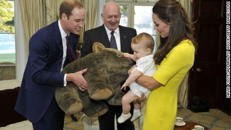 SYDNEY, AUSTRALIA - APRIL 16: In this handout image supplied by Admiralty House, the official Sydney residence of the Governor-General, Prince George of Cambridge, with his parents Prince William, Duke of Cambridge and Catherine, Duchess of Cambridge, receives a gift from the Governor-General Sir Peter Cosgrove at Admiralty House, on April 16, 2014 in Sydney, Australia. The Duke and Duchess of Cambridge are on a three-week tour of Australia and New Zealand, the first official trip overseas with their son, Prince George of Cambridge. (Photo by David Foote /Admiralty House via Getty Images)