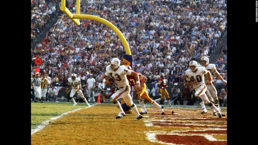 Miami safety Jake Scott intercepts a fourth-quarter pass in the end zone during the Dolphins' 14-7 win over Washington in Super Bowl VII. Scott had two interceptions in the game as the Dolphins finished their season with a perfect 17-0 record. They are still the only NFL team ever to finish a season undefeated.