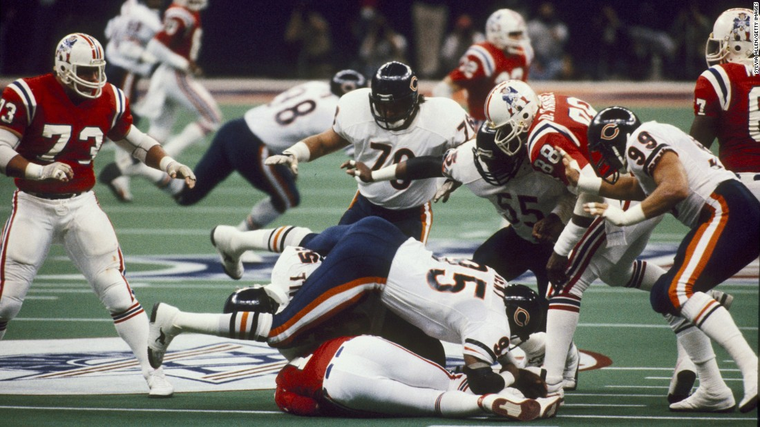 Chicago Bears defensive end Richard Dent (No. 95) sacks New England quarterback Steve Grogan during Super Bowl XX. Dent had two sacks and two forced fumbles as a devastating defense helped Chicago crush the Patriots 46-10.