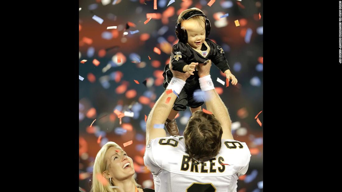 New Orleans Saints quarterback Drew Brees raises his son Baylen after the Saints beat Indianapolis 31-17 in Super Bowl XLIV. Brees completed 32 of 39 passes for 288 yards and two touchdowns.