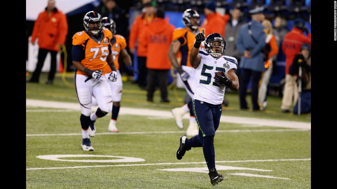 "Seattle Seahawks linebacker Malcolm Smith runs an interception back for a touchdown during Seattle's 43-8 drubbing of Denver in Super Bowl XLVIII. Smith and Seattle's ""Legion of Boom"" defense stifled Peyton Manning and Denver's No. 1-rated offense."