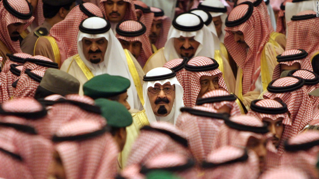 King Abdullah is surrounded by hundreds of Islamic clerics, tribal chiefs and other prominent Saudis before a ceremony bestowing his legitimacy in August 2005.