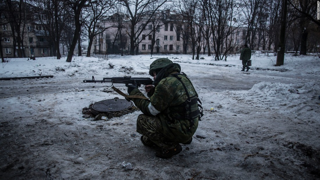 A rebel takes aim while protecting a supply position in the Kievsky district of Donetsk on January 22.