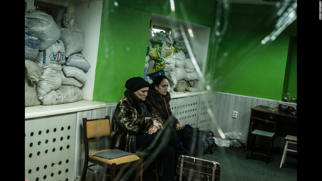 Women sit in a shelter during a battle in Donetsk on Sunday, January 18.