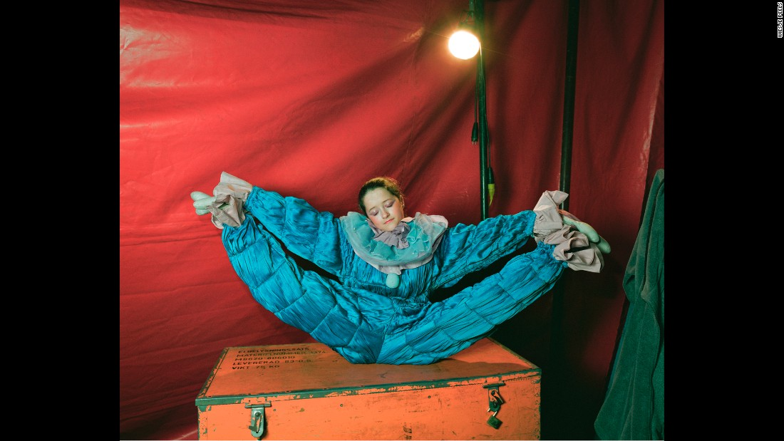 "A clown from a traveling circus stretches backstage in Belgium. Dutch photographer Wiesje Peels has followed several circuses in Europe. The photos in her book ""Mimus"" capture a glimpse of the performers' ""hidden life."""