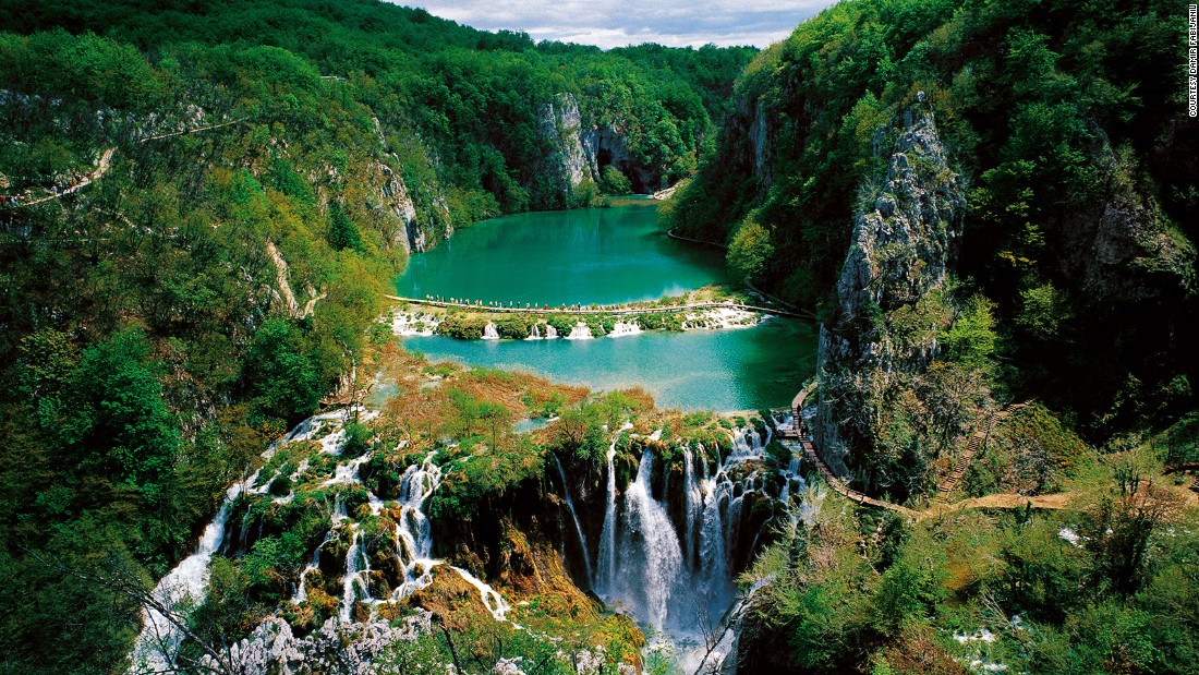 Surrounded by forests of beech, fir and spruce, a multi-level system of 16 lakes spills into waterfalls and pools in Croatia's Plitvice Lakes National Park. The lakes are known for their distinctive colors, which can be turquoise, green, blue or gray. No swimming is allowed in the pristine pools.