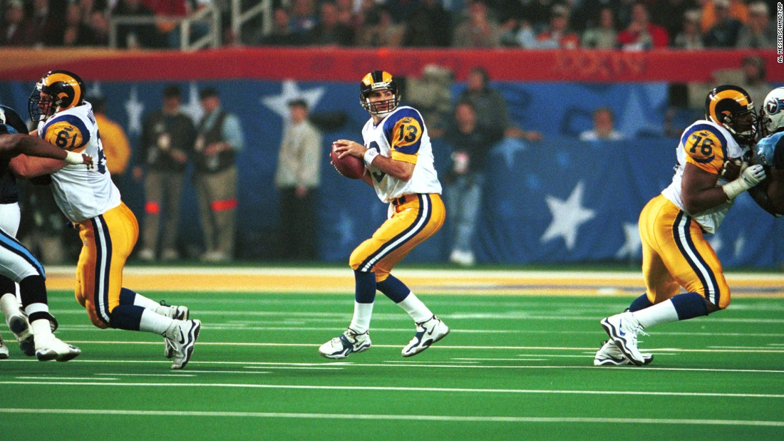 "St. Louis Rams quarterback Kurt Warner, who led an offense nicknamed ""The Greatest Show on Turf,"" threw for a Super Bowl-record 414 yards in 2000. The Rams defeated Tennessee 23-16."