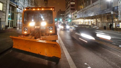 A New York City snowplow, loaded with salt, sits parked in midtown Manhattan as light snow falls, Monday, Jan. 26, 2015. Northeast residents are girding for a heavy snowstorm that could bury communities from northern New Jersey to southern Maine in up to 2 feet of snow. (AP Photo/Mark Lennihan)
