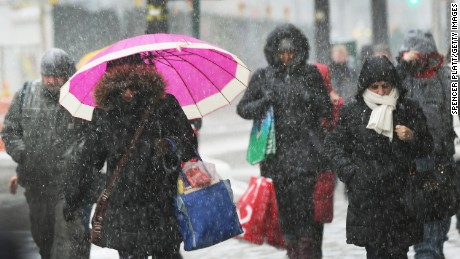 NEW YORK, NY - JANUARY 26:  People walk along a Manhattan street in heavy snow on January 26, 2015 in New York City. New York, and much of the Northeast, is bracing for a major winter storm which is expected to bring blizzard conditions and 18 to 24 inches of snow to the area. New York Mayor Bill de Blasio has announced that only emergency vehicles will be allowed on area roads after 11pm.  (Photo by Spencer Platt/Getty Images)