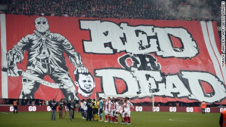 Standard Liege fans display a banner depicting the decapitation of Anderlecht midfielder Steven Defour before the Jupiler Pro League match