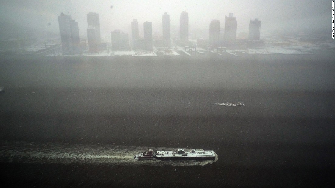 A tugboat sails on the East River in New York on January 26.