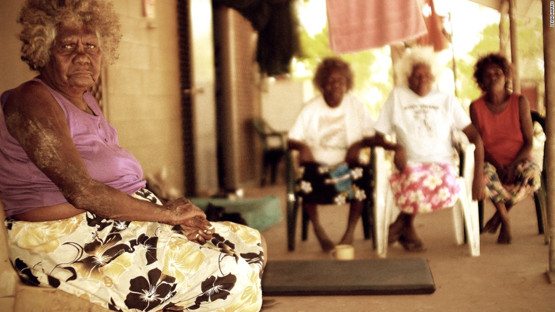Katie Wolmby waits to be picked up at Wathanin Outstation in Queensland, with other elders Lois Koomeeta, Peace Woolla and Jean Walmbeng.