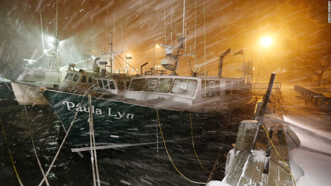 Fishing boats ride out the storm at a dock in Scituate on January 27.